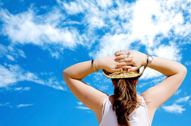 girl relaxing on a sunny day with a beautiful blue sky in the background.jpeg
